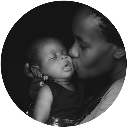 Black and white photo of a mother kissing her babby to signifyyear of creation of MLM companies
