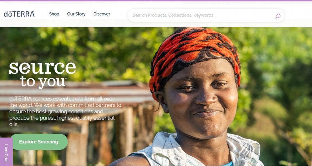 Smiling African woman with forest in the background and the words 'doterra, secure to you' for 19 mlm companies we reviewed and recommended in 2019