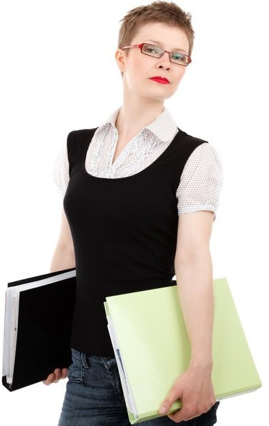 A lady carrying two big files to signify act as a virtual personal assistant