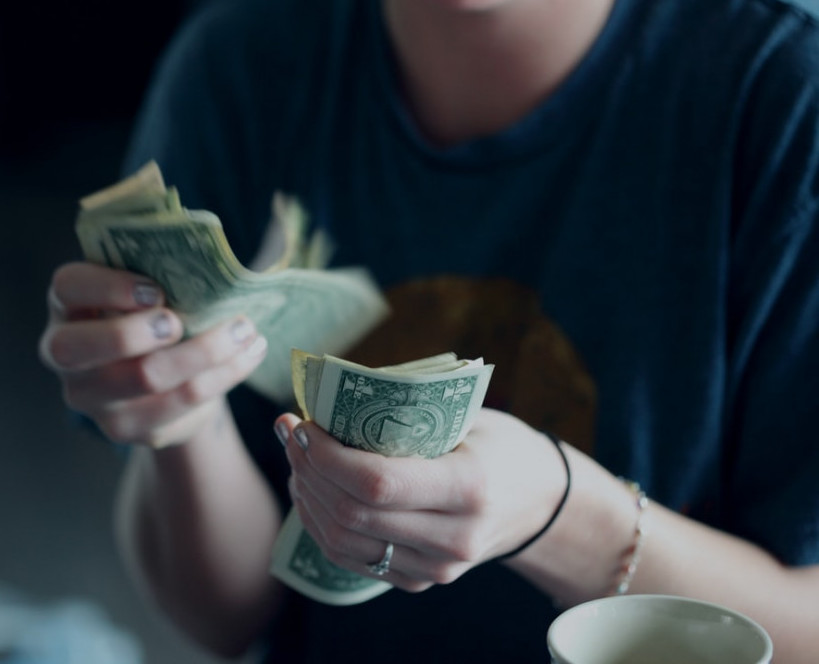 Mancounting money to signify sourcesof income