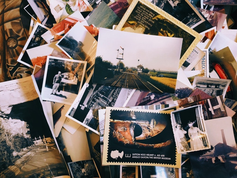 Pile of photographs to say Sell Your Photos to Make Money Fast Online