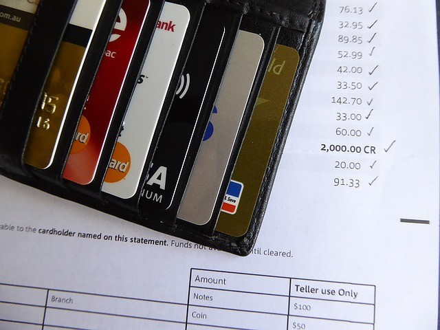 Credit cards in a purselaid on a credit card statement