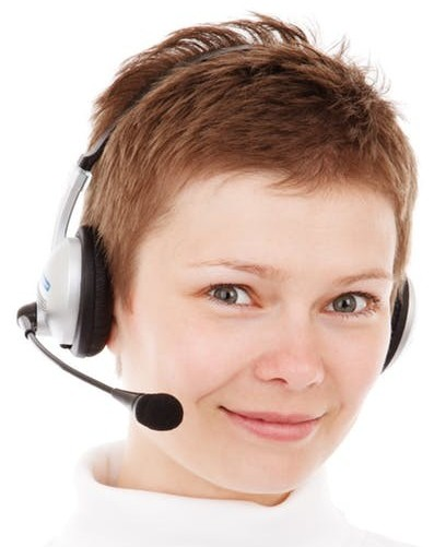 Smiling blonde with headphone to signify Live Help as one of the services offered by Wealthy Affiliate to premium members