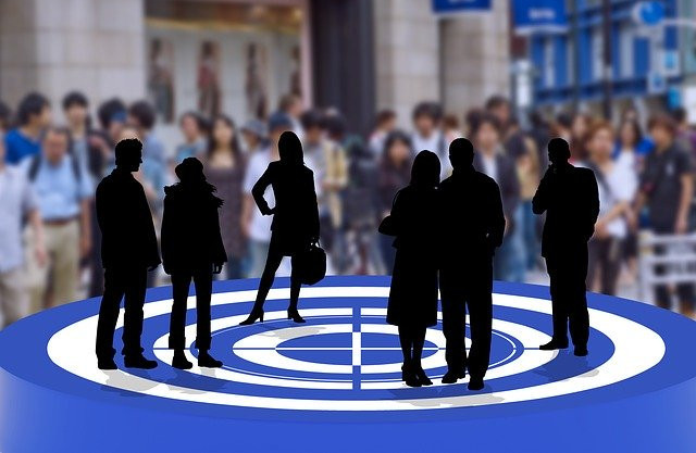 Silhouetted figures on a blue arena with a crowd behind to signify definitions of affilate marketing and its basic terms