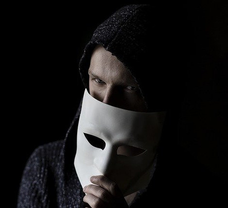 Man covering face with white mask