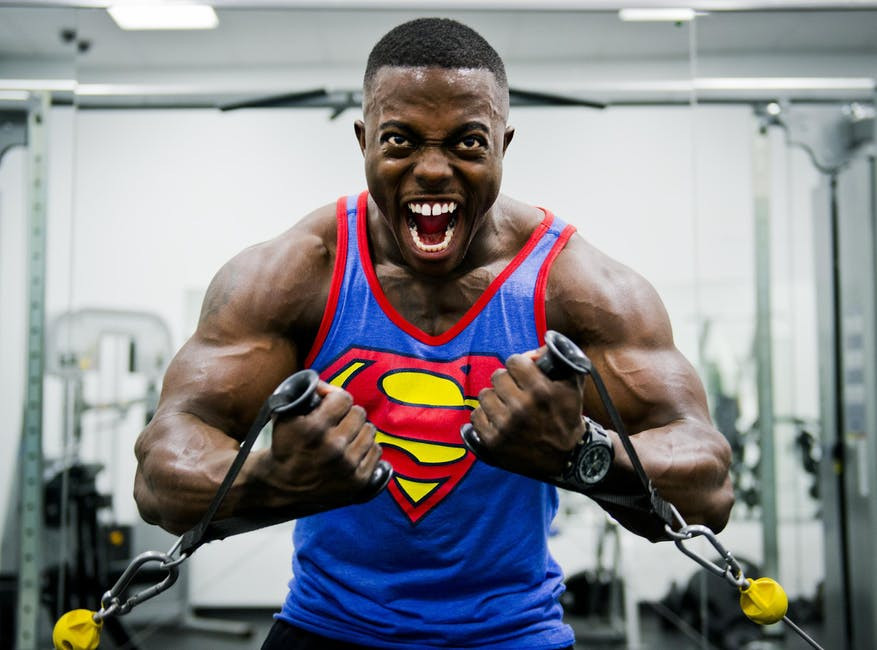 Muscled black man burning fat with stretch chains for Thе Fastest Wау Tо Lose Weight In 4 Weeks