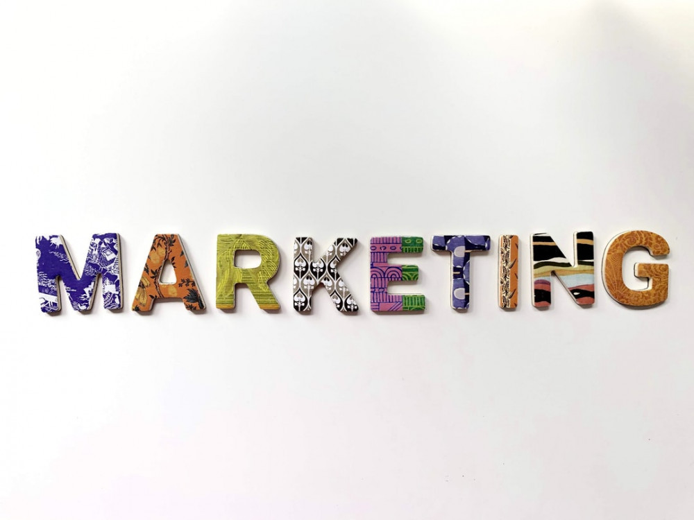 The word MARKETING written with psychedelic images on a white background to signify Affiliate marketing, internet marketing, network marketing, multi-level marketing – Similarities and Differences