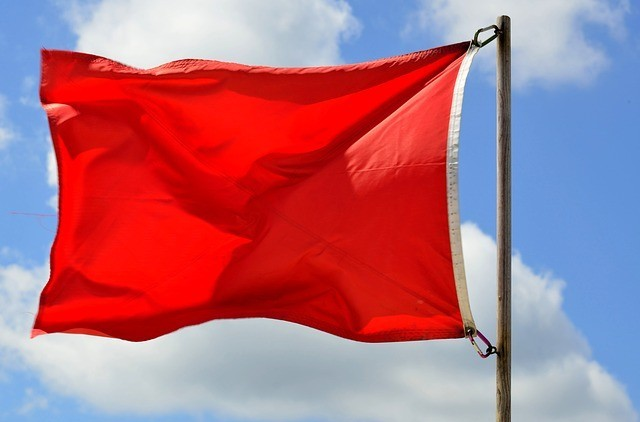 Red flag signalling danger thus Work from Home Risky Opportunities to Avoid Generally