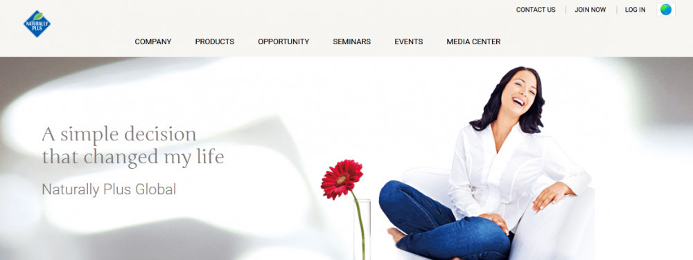 Naturally plus officialwebsite homepage showing a smiling woman beside a sunflower with words 'A simple decision that changed my life'