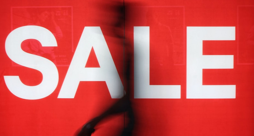 Words SALE in white on a red background with a dark image across it to signify annual sales of MLM companies