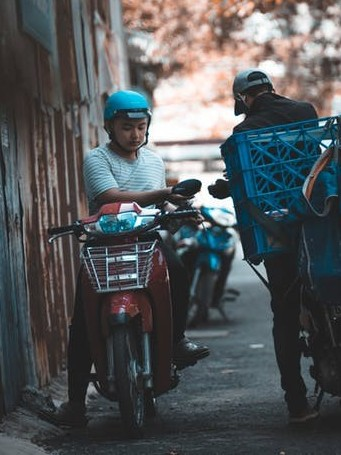 Bicycle loaded with crates to signify deliver groceries to earn money