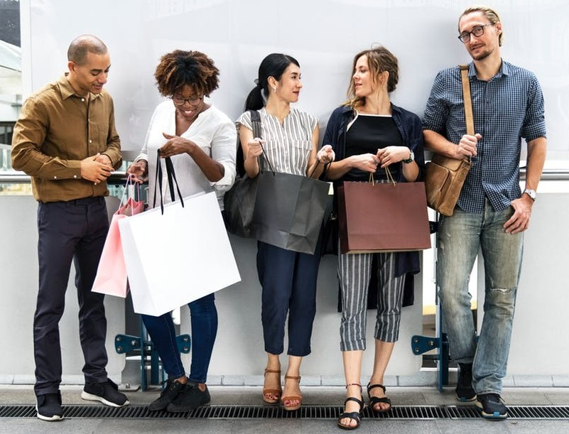 People with shopping bags to say get paid to shop