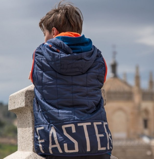 Boy leaning against a grave stone with FASTER written on his sweater to signify how fast websites hosted at Wealthy Affiliate are with SiteSpeed