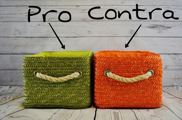 2 cushions with words Pro & Contra pointing to them to signify Proas and Cons of MLM companies