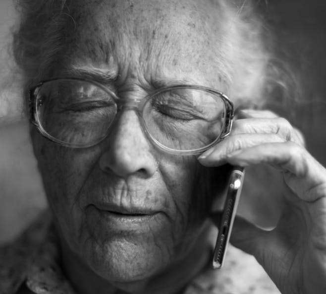 Old Woman On Phone For Social Security Call Scams