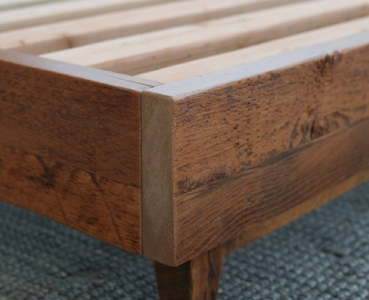 close up of bed frame showing reclaimed wood