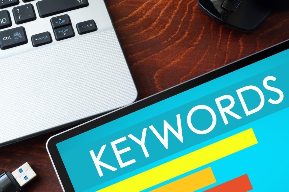 a monitor displaying keywords.
