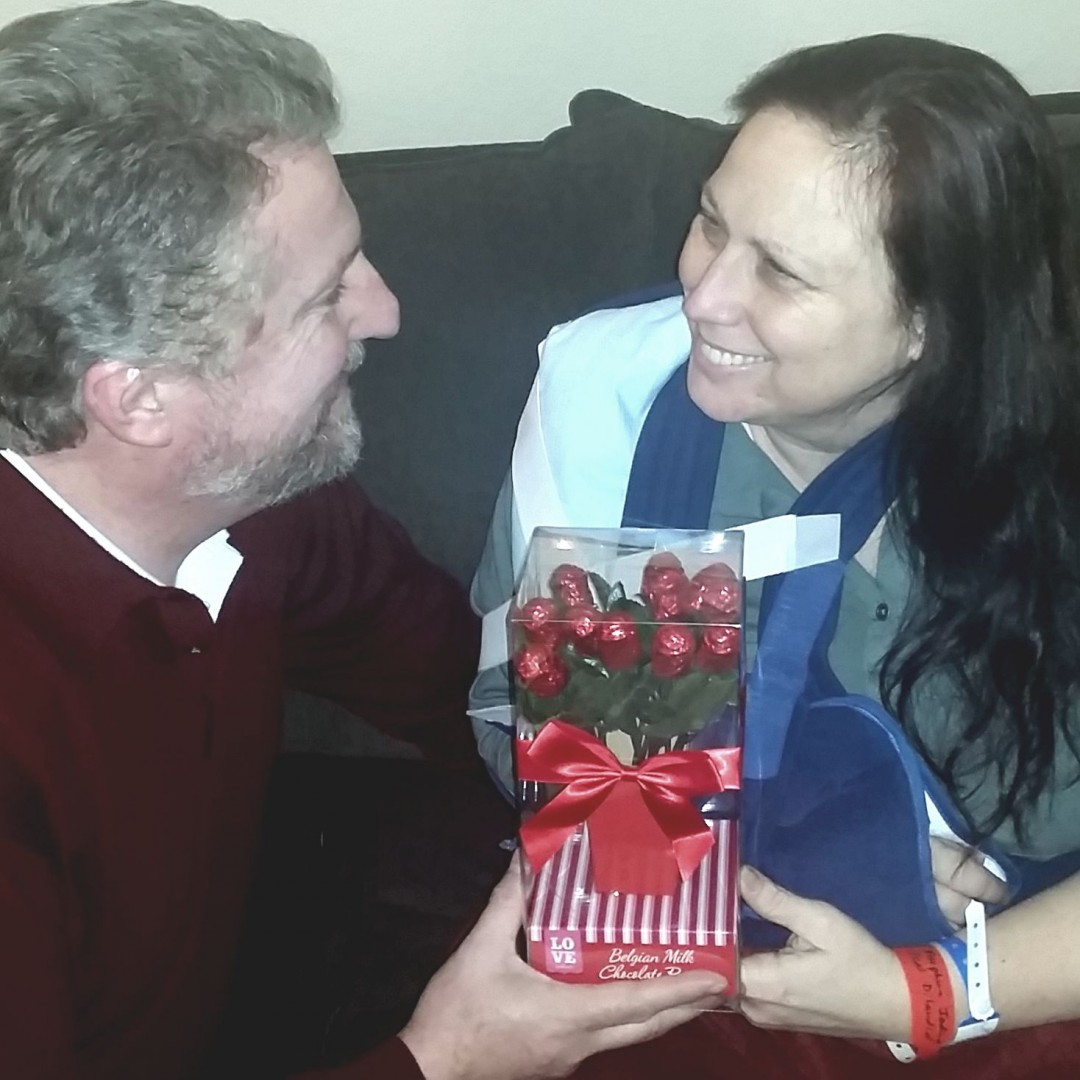 Mark presenting me with a bouquet of chocolate roses the day after surgery