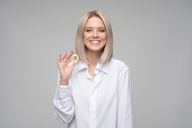 a woman holding a bitcoin