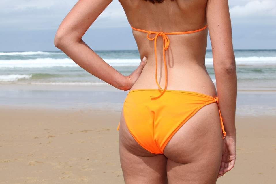 a woman with cellulite on the beach