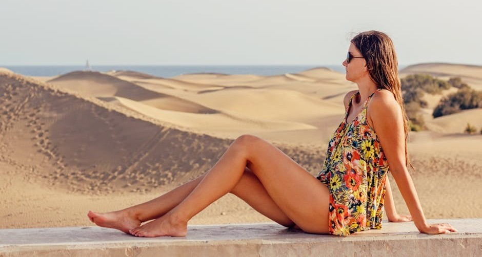 A woman with beautiful legs near dunes