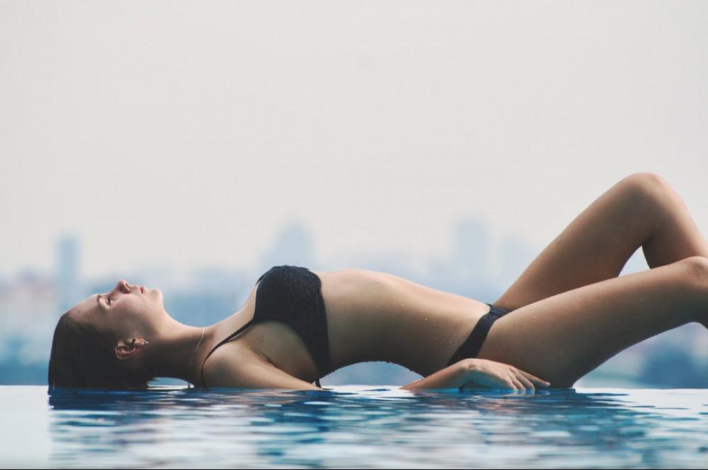 slim woman in water