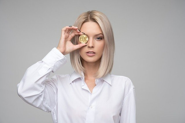 a woman with a crypto coin