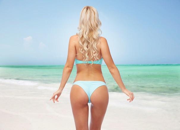 a woman in bikini on the beach