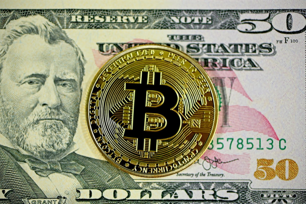a bitcoin on a 50 dollars note