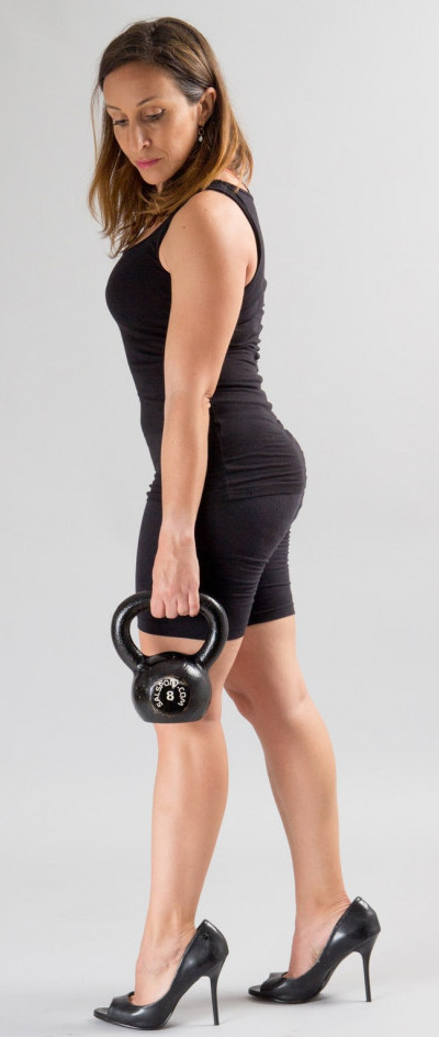 a woman with a dumbbells