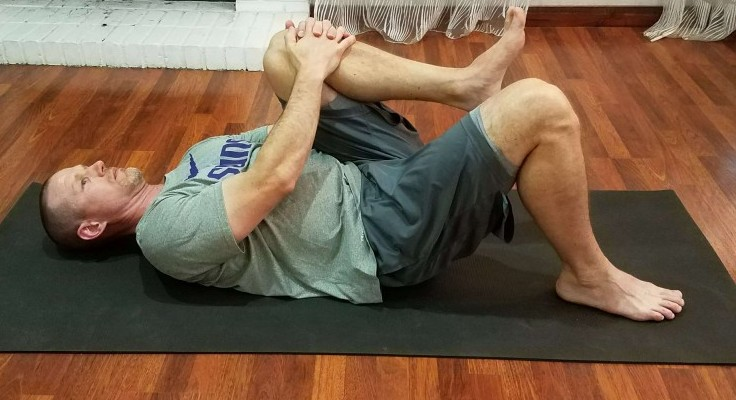 Chest to knee stretch with leg bent