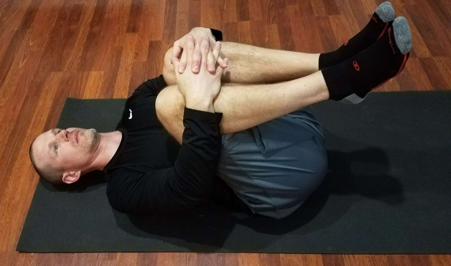 Chest to knee stretch with both legs
