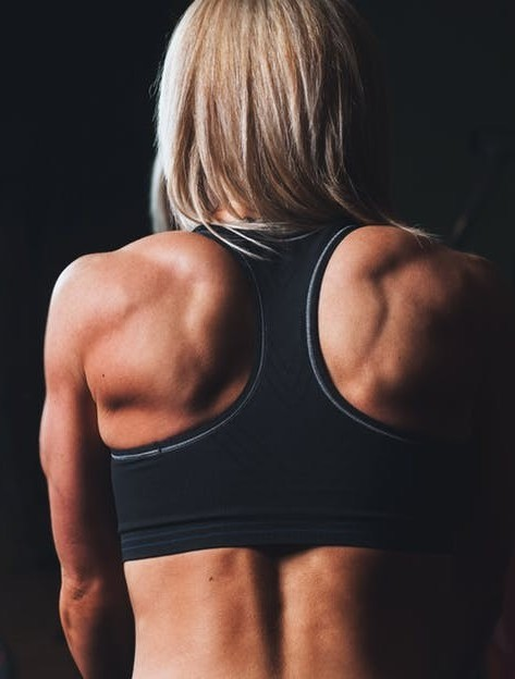Womans back after performing back exercises for lower back pain