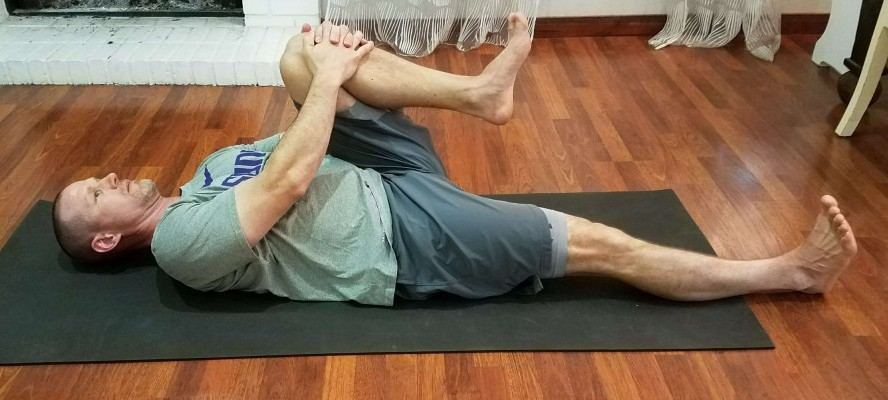 Chest to knee stretch with straight leg