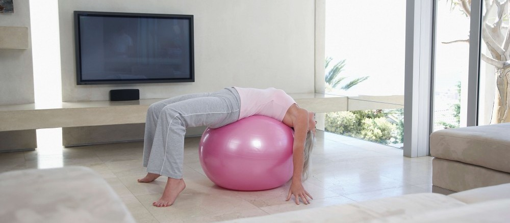 Stretching on a swiss ball