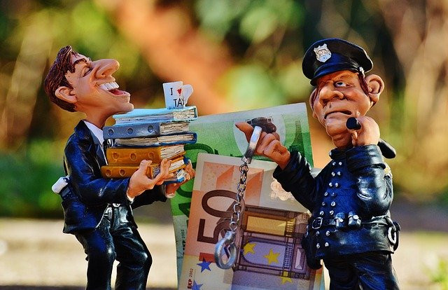 What is a scam - police man catching a scammer