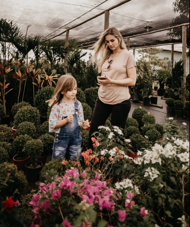 Mother and daughter shopping for  flowers