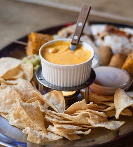 cheese sauce and nachos
