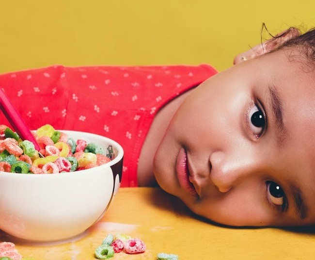 little girl with bowl of cereal