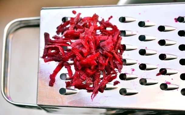 grater with shredded beets