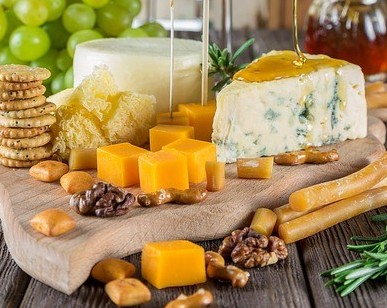 different types of cheese on serving board