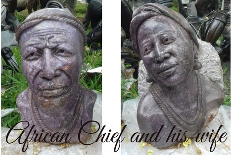 African chief and wife stone sculpture