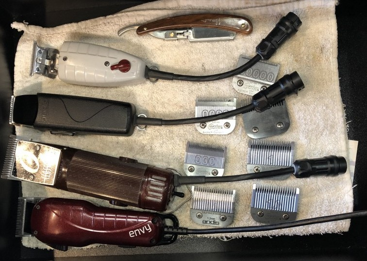 The omnicord hooked up to the clippers tucked away neatly in a drawer