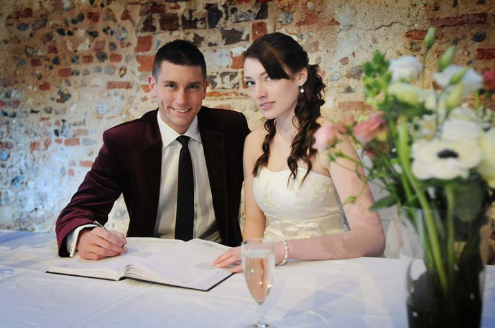 Happy couple at Dragon Hall, historic wedding venue in Norwich