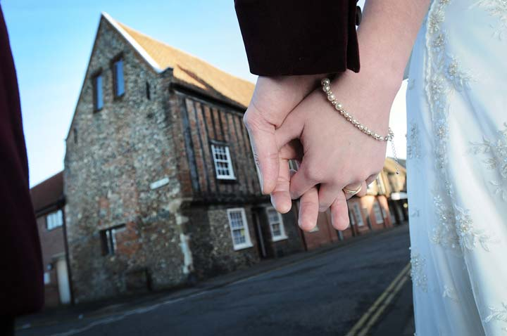 Holding hands outside Dragon Hall wedding venue