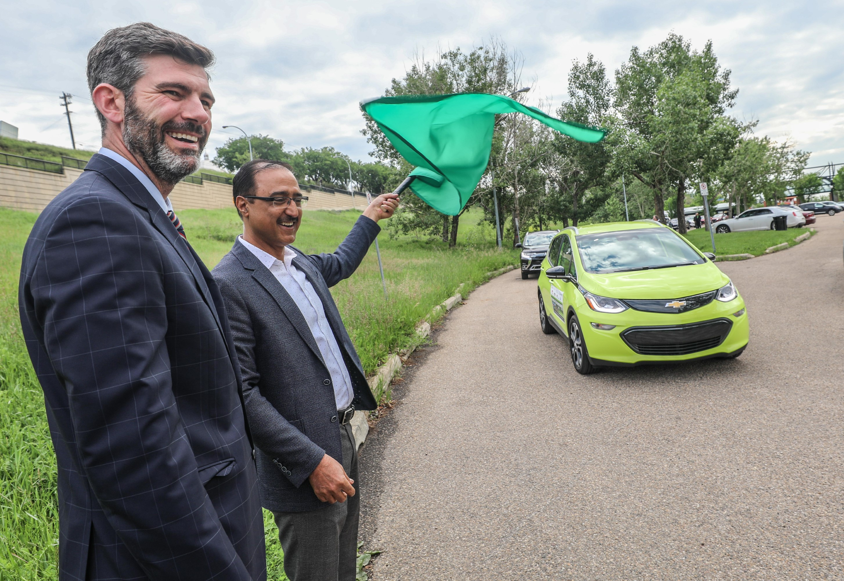 Minister Sohi and Mayor Iveson waving the green flag
