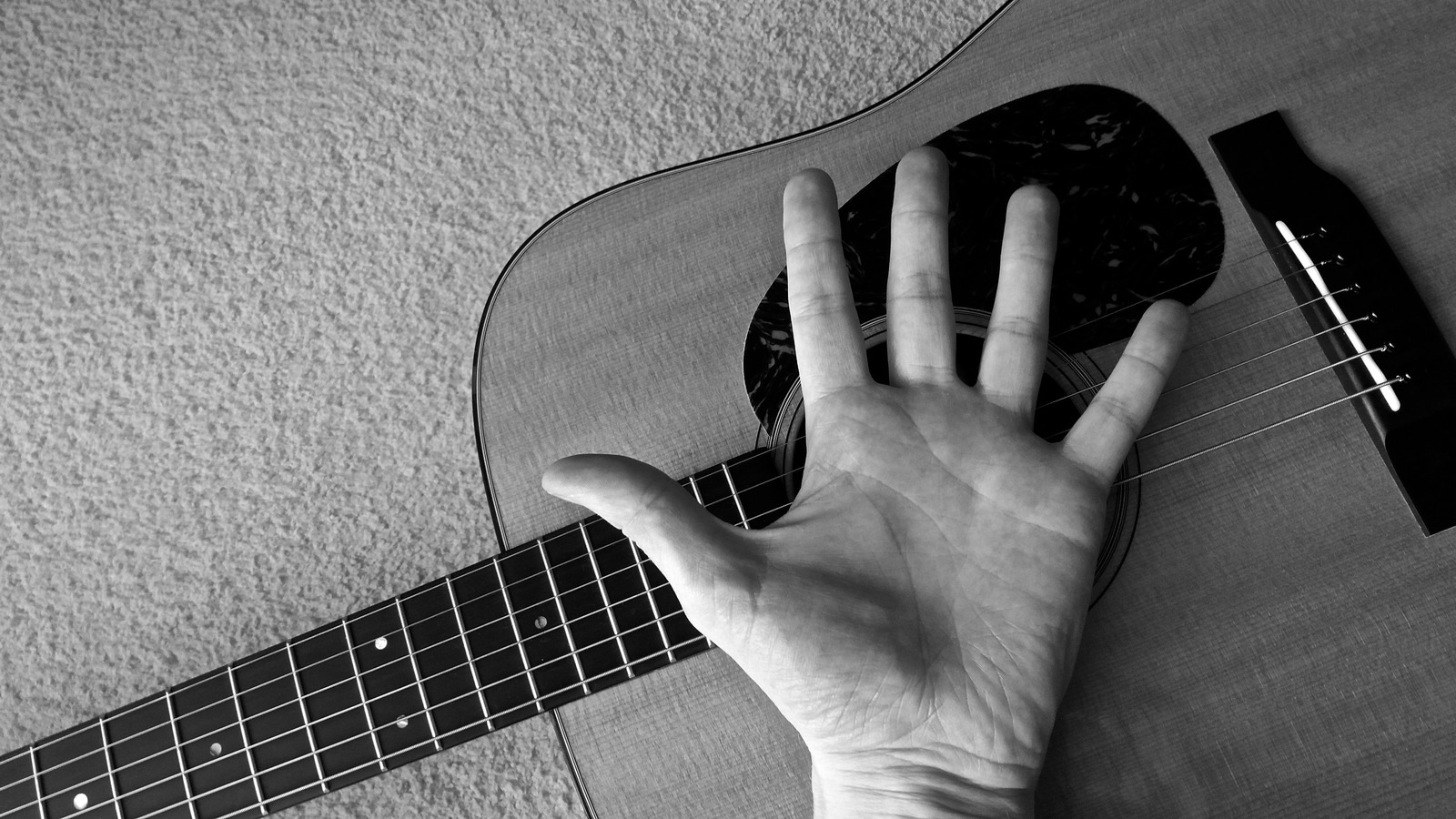 playing guitar with big hands