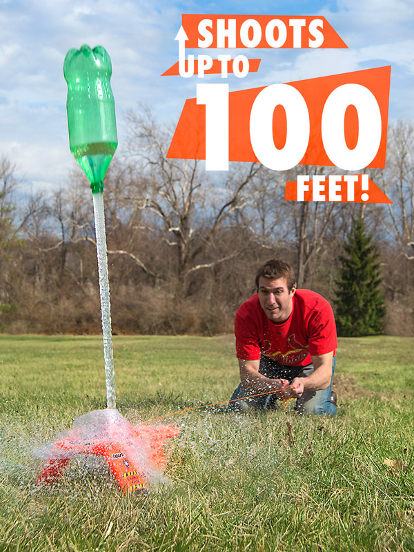 Man shooting a 2L bottle with the AquaPod Bottle Rocket.