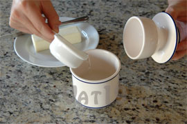 Add 1/3 cup of water to the base of your Butter Bell French Butter Keeper.