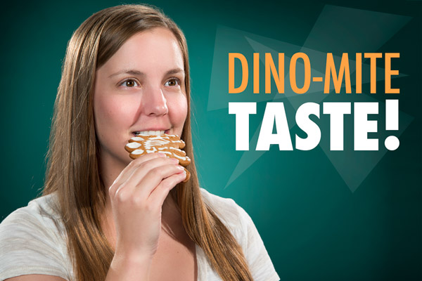 Woman enjoying the mouth-watering taste of her Dinosaur Fossil Cookie.